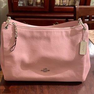 Light pink Coach purse.